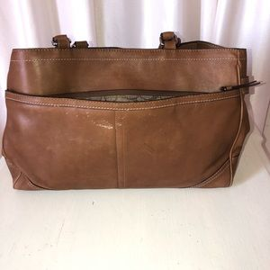Coach brown leather courier bag.